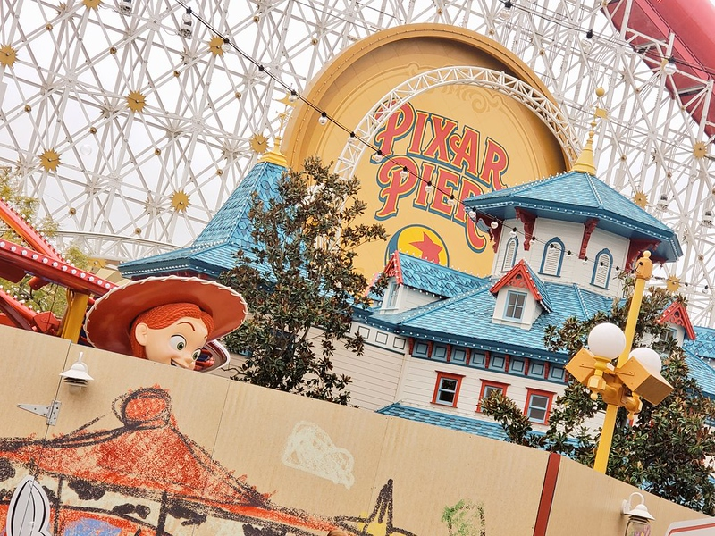 Jessie the yodeling cowgirl appears at her new Pixar Pier attraction ahead of April 2019 opening