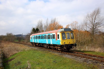 121032 in the remnants of Arriva Trains Wales livery works the 1350 Redmire to Leeming Bar away from Leyburn on the 30th March 2018