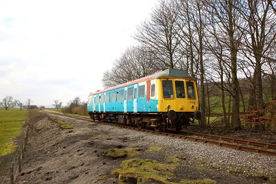 121032 in the remnants of Arriva Trains Wales livery works the 1350 Redmire to Leeming Bar approaches Wensley on the 30th March 2018