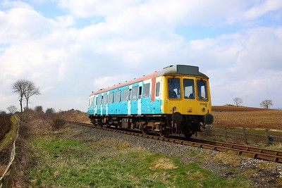 121032 in the remnants of Arriva Trains Wales livery works the 1350 Redmire to Leeming Bar approaches Bedale at Sinks Lane on the 30th March 2018