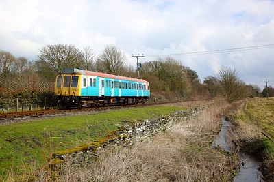 121032 in the remnants of Arriva Trains Wales livery works the 1350 Redmire to Leeming Bar away from Leyburn on the 30th March 2018 1