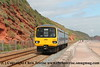 Class 143 2 Car Pacer DMU Set number 143 612 passes Dawlish with 2T17 1323 Exmouth to Paignton.<br /> 21st August 2017
