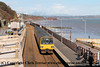 Class 143 2 Car Pacer DMU number 143 612 in multiple with 143 620 arrives at Dawlish with 2T20 1423 Exmouth to Paignton.<br /> 11th April 2013