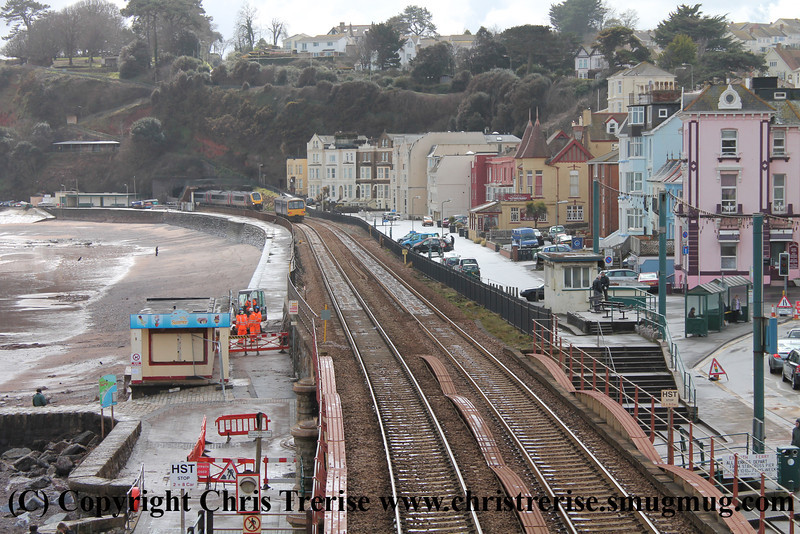 Class 143 2 Car Pacer DMU number 143 603 departs Dawlish with 2T19 1323 Exmouth to Paignton as Class 220 4 Car Voyager DEMU number 220 021 approaches with 1M93 1401 Paignton to Manchester Piccadilly.<br /> 11th April 2013