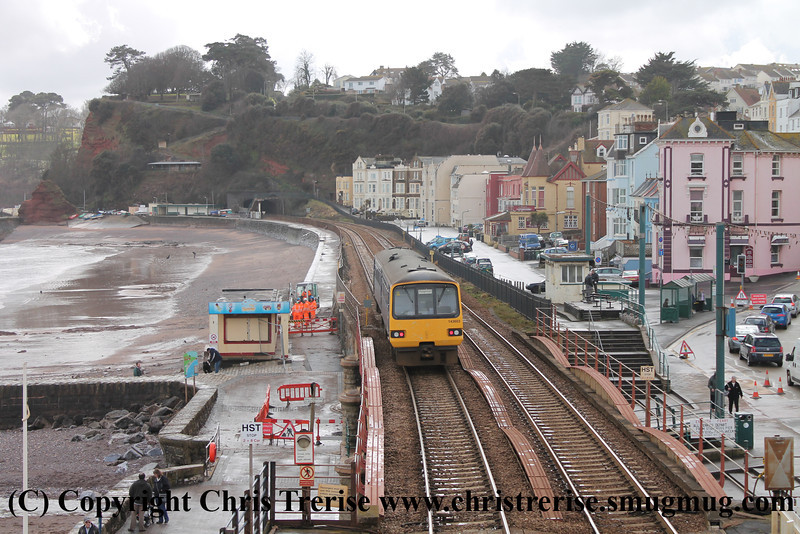 Class 143 2 Car Pacer DMU number 143 603 departs Dawlish with 2T19 1323 Exmouth to Paignton.<br /> 11th April 2013
