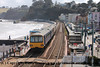 Class 143 2 Car Pacer DMU number 143 612 in multiple with 143 620 depart Dawlish with 2T20 1423 Exmouth to Paignton.<br /> 11th April 2013