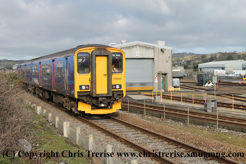 Class 150 2 Car Sprinter DMU number 150 244 passes Long Rock with 2A06 0815 St Ives to Penzance.<br /> 12th April 2013