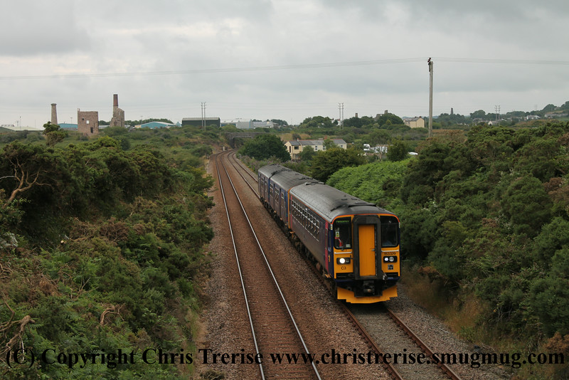 Class 153 Single Car Sprinter DMU Set number 153 329 in multiple with Class 150 2 Car Sprinter DMU Set number 150 244 pass Brea Village with 2C51 1755 Plymouth to Penzance.<br /> 19th July 2014