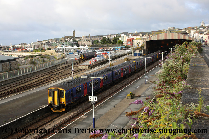 Sunday morning at Penzance.  Class 153 Single Car DMU number 153 372 stabled in the sidings with Platform 2 full of stabled Class 150 2 Car DMUs numbers 150 232, 150 265, 150 120 and 150 123.<br /> 12th August 2012
