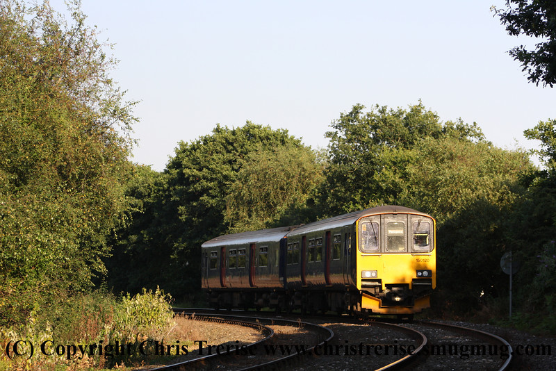 Class 150 2 Car Sprinter DMU number 150 120 passes St Blazey with the 1829 Par to Newquay.<br /> 10th August 2012