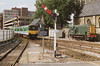 Class 150/1 2 Car Sprinter DMU Set number 150 121 departs Lincoln with the 1354 Lincoln to Grimsby Town, passing preserved Class 08 Diesel Shunter number D3167.<br /> 25th August 1992