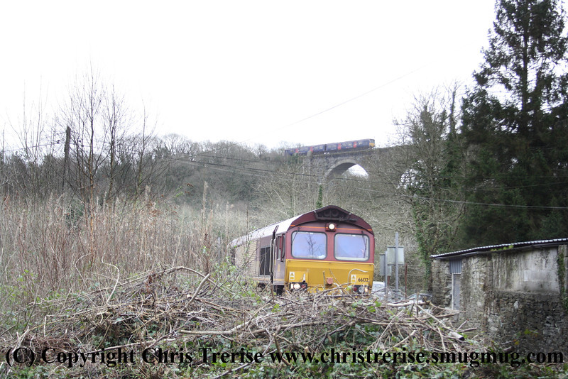 Class 66 Diesel Locomotive number 66 132 approaches Moorswater with 6Z17 0653 Westbury to Moorswater cement working.  On the main line above Class 150 2 Car Sprinter DMU number 150 xxx crosses with 2A63 1141 Penzance to Newton Abbot.<br /> 4th February 2013