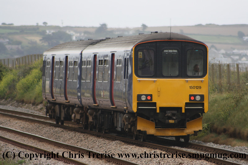 Class 150 2 Car Sprinter DMU number 150 129 passes Long Rock with the 1300 Penzance to Plymouth.<br /> 23rd June 2012
