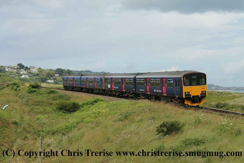 Class 150 2 Car Sprinter DMU Set numbers 150 129 + 150 243 pass Porthkidney Beach with 2A25 1348 St Erth to St Ives.<br /> 27th June 2014