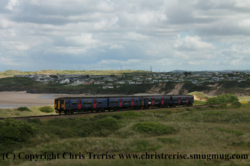 Class 150 2 Car Sprinter DMU Set numbers 150 129 + 150 243 pass Porthkidney Beach with 2A24 1333 St Ives to St Erth.<br /> 27th June 2014