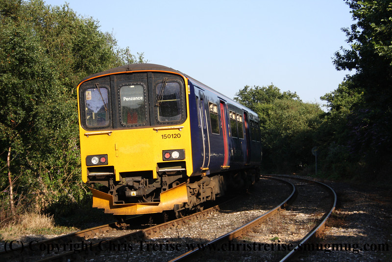 Class 150 2 Car Sprinter DMU number 150 120 passes St Blazey with the 1722 Newquay to Par.<br /> 10th August 2012