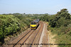 Class 153 Single Car DMU number 153 329 leads Class 150 2 Car Sprinter DMU number 150 131 through Chacewater with the 0642 Bristol Temple Meads to Penzance.<br /> 10th August 2012