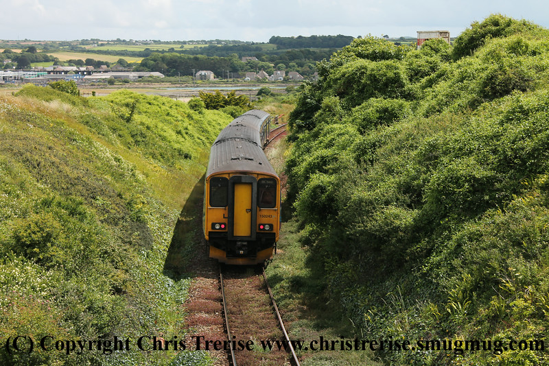 Class 150 2 Car Sprinter DMU Set numbers 150 129 + 150 243 pass Porthkidney Beach with 2A26 1403 St Ives to St Erth.<br /> 27th June 2014