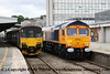 Class 66 Diesel Locomotive number 66 775 at Plymouth running light as 0Z31 11.30 Westbury to Devonport Dockyard.  The loco is due to be named HMS Argyll on 11 July 2017.  Class 150 2 Car Sprinter DMU Set number 150 124 is alongside having arrived with 2P89 1345 from Gunnislake.<br /> 10 July 2017