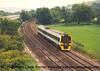 Class 158 2 Car DMU number 158 829 passes Moorhaven.<br /> May 2001