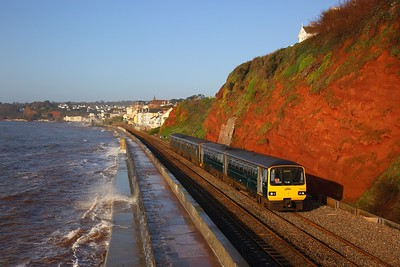 143619+150248 on the 2F09 Paignton to Exmouth (Pacer as far as Exeter SD) at Rockstone Bridge, Dawlish on the 18th April 2018
