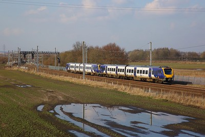 195011+195014 on the 1D76 Leeds to Chester at Winwick Junction on the 6th March 2020