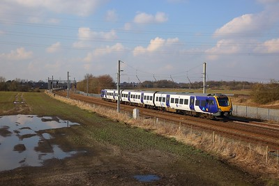 195114 on the 1D77 1242 Leeds to Chester at Winwick junction on the 6th March 2020