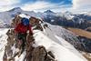 A mountaineer traverses a rock ridge towards the summit of Mount Annette, Sealy Range, Aoraki Mount Cook National Park
