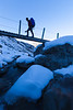 Mountaineer crossing the Otira Valley footbridge, Arthur's Pass National Park