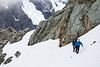 The climbers traverse snowfield. Mount Tutoko in background, Fiordland National Park