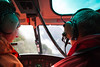 Climber and pilot inside helicoper with headsets on, Fiordland National Park