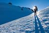Female climber ascending snow towards summit of Mount Tapuae-o-uenuku, Inland Kaikoura Range