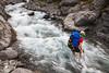 Female climber crossing the Hodder River, Mount Tapuae-o-uenuku, Inland Kaikoura Range
