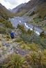 Female climber walking up Hodder Valley, Mount Tapuae-o-uenuku, Inland Kaikoura Range