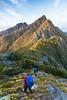 Two trampers (male, female) descending Mount Douglas towards the Dragons Teeth, Kahurangi National Park