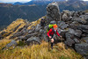 Two trampers climb to Lathrop Saddle, Kokatahi Whitcombe Area