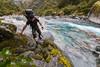 Male tramper in the upper Kokatahi Stream, Zit Saddle Route