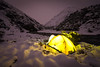 Tent pitched in fresh snow beside the Arrow River, Motatapu Track, Harris Mountains, Otago