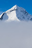 West Face, South West Ridge and South Face of Mount Aspiring above valley cloud, Mount Aspiring National Park