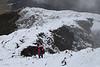 Trampers descend French Ridge during storm, Mount Aspiring National Park