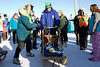 IMG_1439  Musher Kim Wells shows Anchorage Mayor Dan Sullivan how to operate a dog sled.