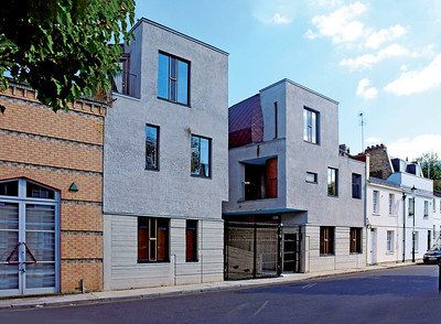 12 Walmer Yard. 235–239 Walmer Road, Kensington and Chelsea. Salter Collingridge. 2016. Two of the street-facing fronts of the scheme of four interlocking town houses made from cast concrete