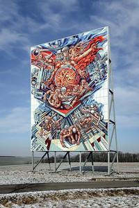 06 Löbichau, Thüringen (ehem. SDAG Wismut), 1974: Die friedliche Nutzung der Kernenergie, Werner Petzold. Fassadengestaltung, Freifläche, frei stehend, Malerei auf Email, 12×16 Meter