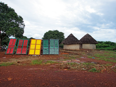Shutters for sale near Coyah, Kindia Region, Guinea, which usually are used in urban areas for shops