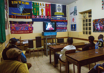14 Eritrean men watching an international football match