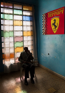 11 Eritrean man sitting in front of a Ferrari flag in Asmara