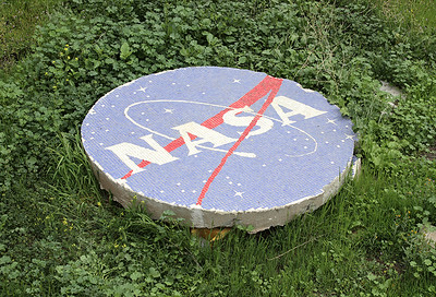 NASA insignia at the Swedish Space Corporation (NASA's former satellite tracking station),Peldehue, Chile, 2015. Dating from the early 1960s, this is a rounded concrete slab of 2.05 m in diameter covered with tiles.Photo: Hugo Palmarola