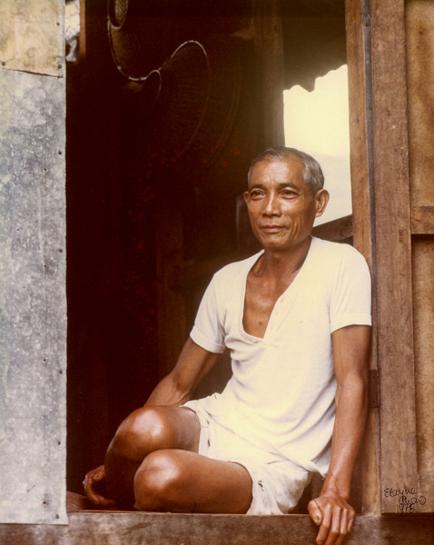 103 PHILLIPINES MAN IN DOORWAY REV01