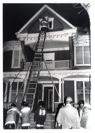50' BANGOR LADDER BEING USED AT 942 MAPLE  2-13-80