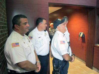 BOSSES AND PHIL WAITING FOR HONOR GUARD TO OPEN BADGE CASE